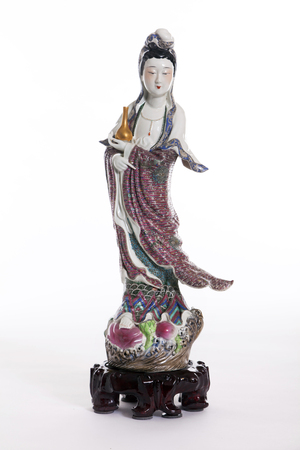 female likeness: Guanyin statue on white background.