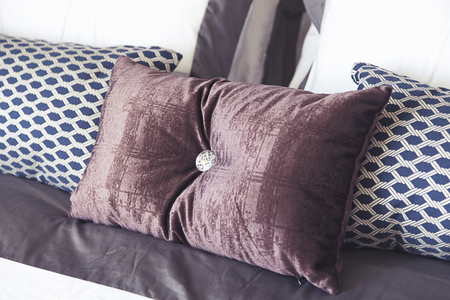 bedding: pillows setting on classic style bedding,bedroom. Stock Photo