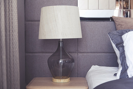 table lamp by the classic style bedding 免版税图像 - 50906275