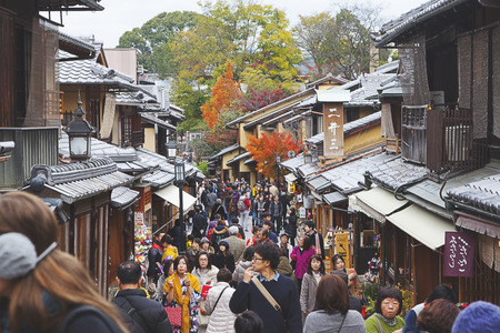 Many tourists walk in Gion area in Kyoto Japan