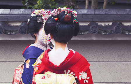 Apprentice geisha,Maiko couple walking in Kyoto, Japan