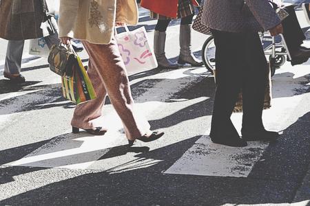 hectic: people on zebra crossing street,vintage filter.