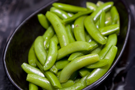 snap bean: The boiled snap peas in a plate Stock Photo