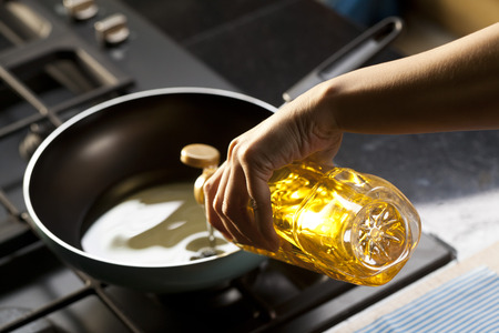 Pouring vegetable oil into frying pan
