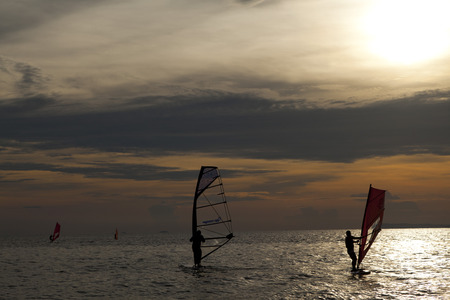 windsurfers: windsurfers enjoy surfing at Jomtien Beach, Pattaya, Thailand