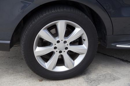 alloy: Modern automotive wheel on alloy disc Stock Photo