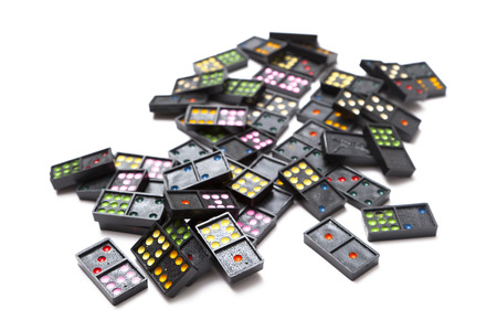 inflexible: Pile of colorful dominoes