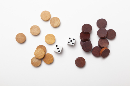 backgammon: 2 dice and wood chess on white background