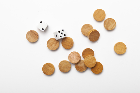 2 dice and wood chess on white background