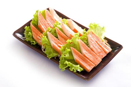 flesh eating animal: imitation crab meat on white, japanese food Stock Photo