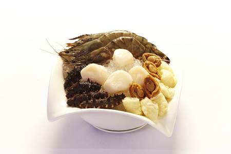 Raw Sea Cucumber ,scallop,abalone and prawn on ice in a bowl