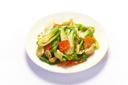 healthful: Stir fried mix colorful vegetables on white background