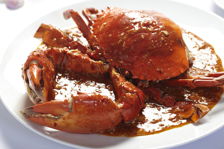 Fried Crab in Curry Powder on white background.