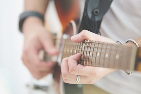 Man playing an acoustic guitar Stock Photo