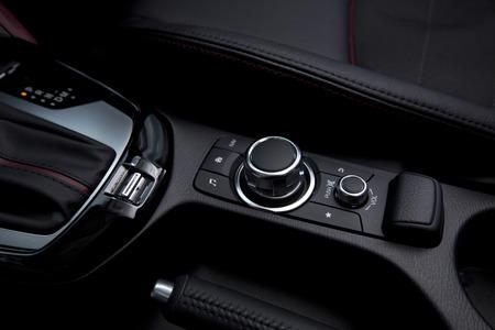 fm: close up of modern car audio entertainment control button