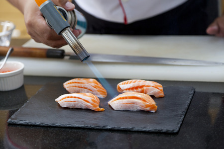 replaces: Japanese chef making salmon sushi - japanese food