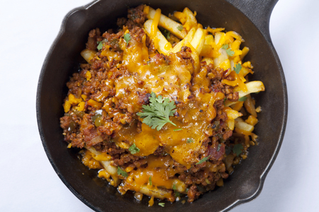 Chili mince pork and French fries in a pan,Mexican food.