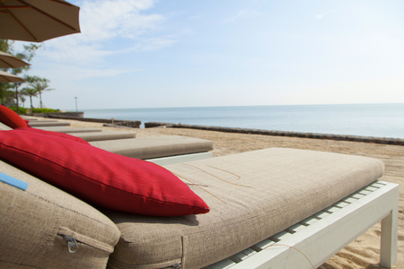 daybed: bright color pillow on daybed by the beach Stock Photo