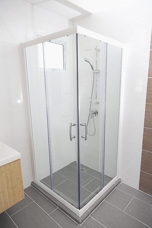 detail of a modern glass shower cabin.