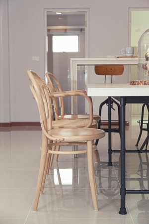 eating area: dining room interior with brown table and chairs. Stock Photo