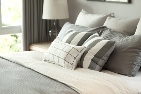 luxury house: grey pillow on bed Stock Photo