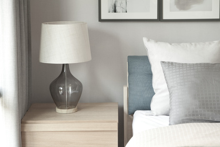 luxury house: grey pillow on bed with lamp