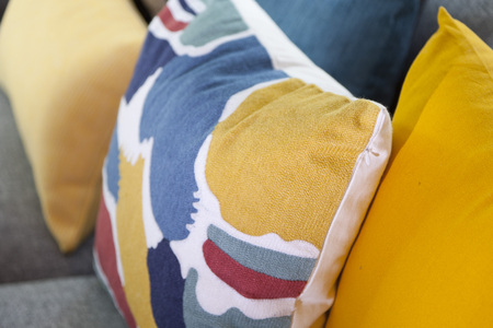 divan: Sofa with colorful pillows in room