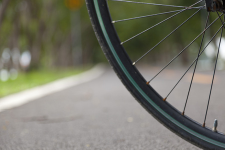 gear handle: mountain bicycle on the road in the green park Stock Photo