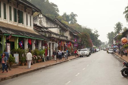 laotian: people walking on Sisavangvong Road, Luang Prabang, Laos