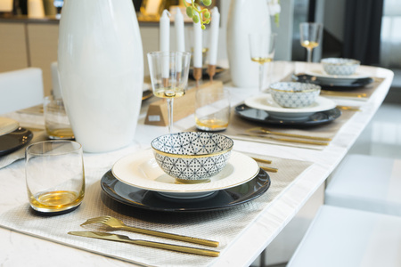 napkin ring: luxury plate setting on dining table Stock Photo