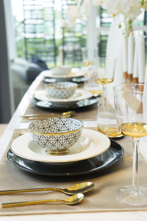luxury plate setting on dining table Stock Photo