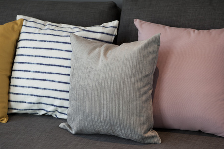 modern living room: Colorful modern pillows on a sofa Stock Photo