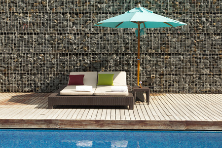 daybed by the pool Stock Photo
