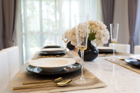 luxury table set on wooden dining table
