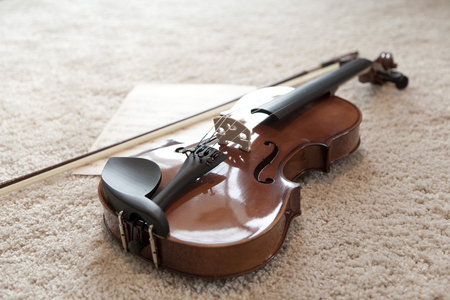 Close up of violin on bed