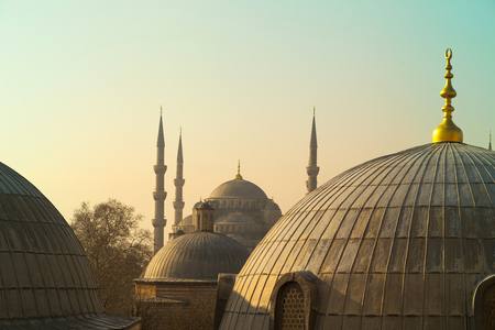 Domes of Saint Sophie Cathedral and Blue Mosque from Saint Sophie Istanbul Turkey.
