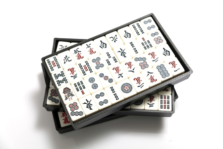 set of wooden mahjong game tiles in box isolated on white background Stok Fotoğraf