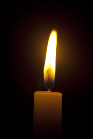 One candle light in the dark Stock Photo