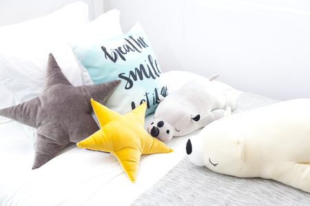 Star pillows and square pillows on wooden beds Stock Photo