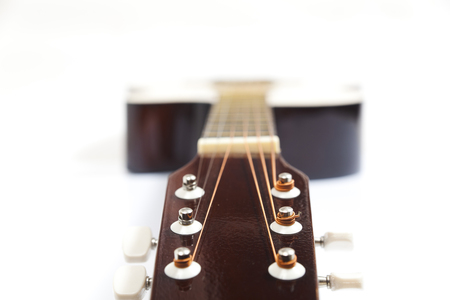 Color photo of acoustic guitar on white background