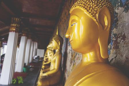 Buddha statue in Temple of The Dawn or Wat Arun in Bangkok, Thailand Banco de Imagens