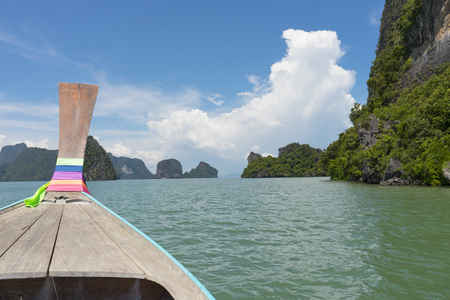 Long tail boat against blue sky in Phang Nga Bay, Thailand Stock Photo