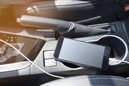 Smartphone in a car use for Navigate or GPS. Driving a car with Smartphone