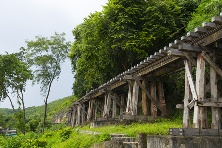 Death Railway train passing over the Tham Krasae Viaduct.