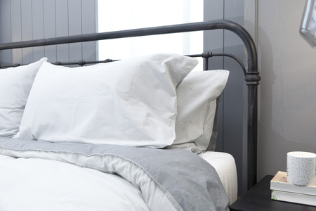 comfortable white and grey pillow on bed