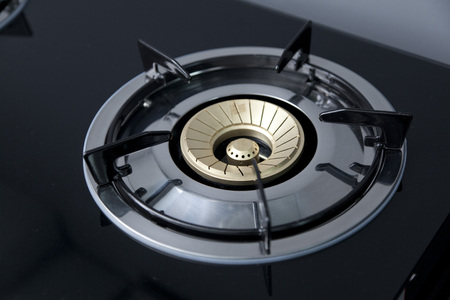 close up of brand new, modern gas stove on counter top in contemporary modern home kitchen.