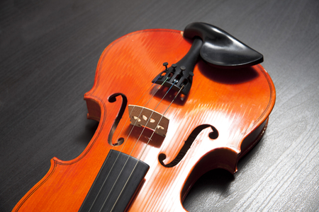 Save Download Preview Classical Wooden Violin on a wooden table