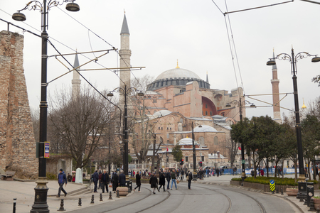 Tourists visiting the Hagia Sophia in front of Sultan Ahmed Park