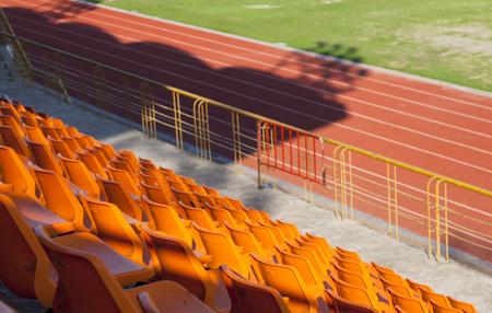 orange seat of football stadium Stock Photo