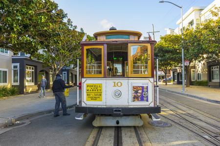 Passenger riding on a famous San Francisco cable car